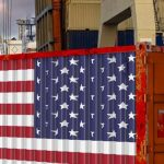 american_container_with_usa_flag_in_port-833x321